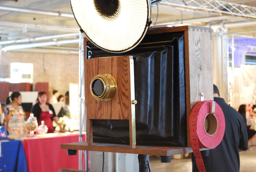 We call her baby dove. Our camera is hand crafted with solid oak dovetail joints, a brass lens, and black leather bellows. Take a ticket to view your pictures later online!