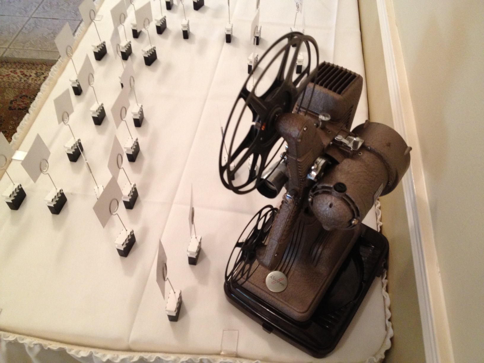Movie themed wedding seat arrangements with vintage 16mm film projector.