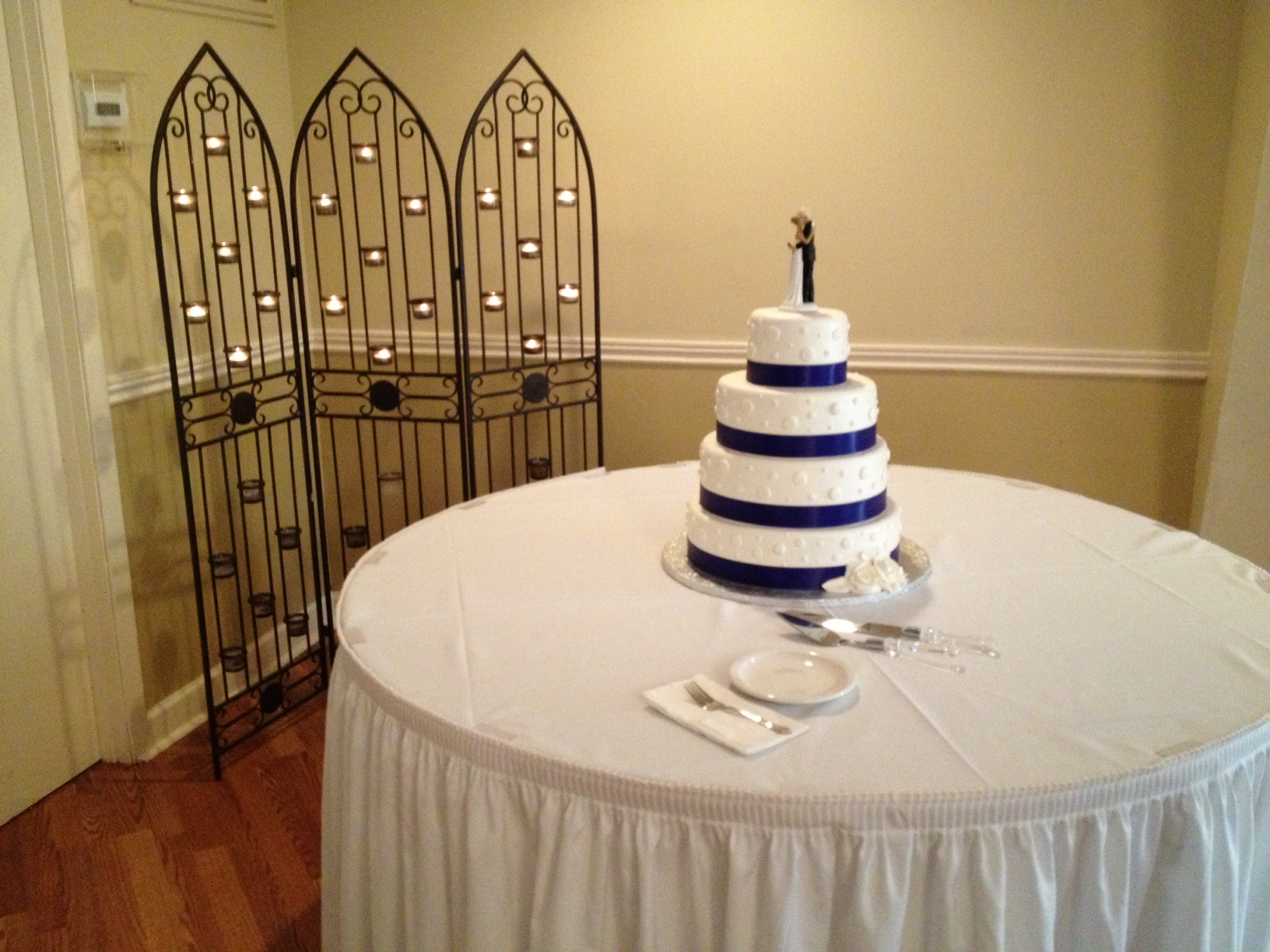 Blue striped wedding cake.