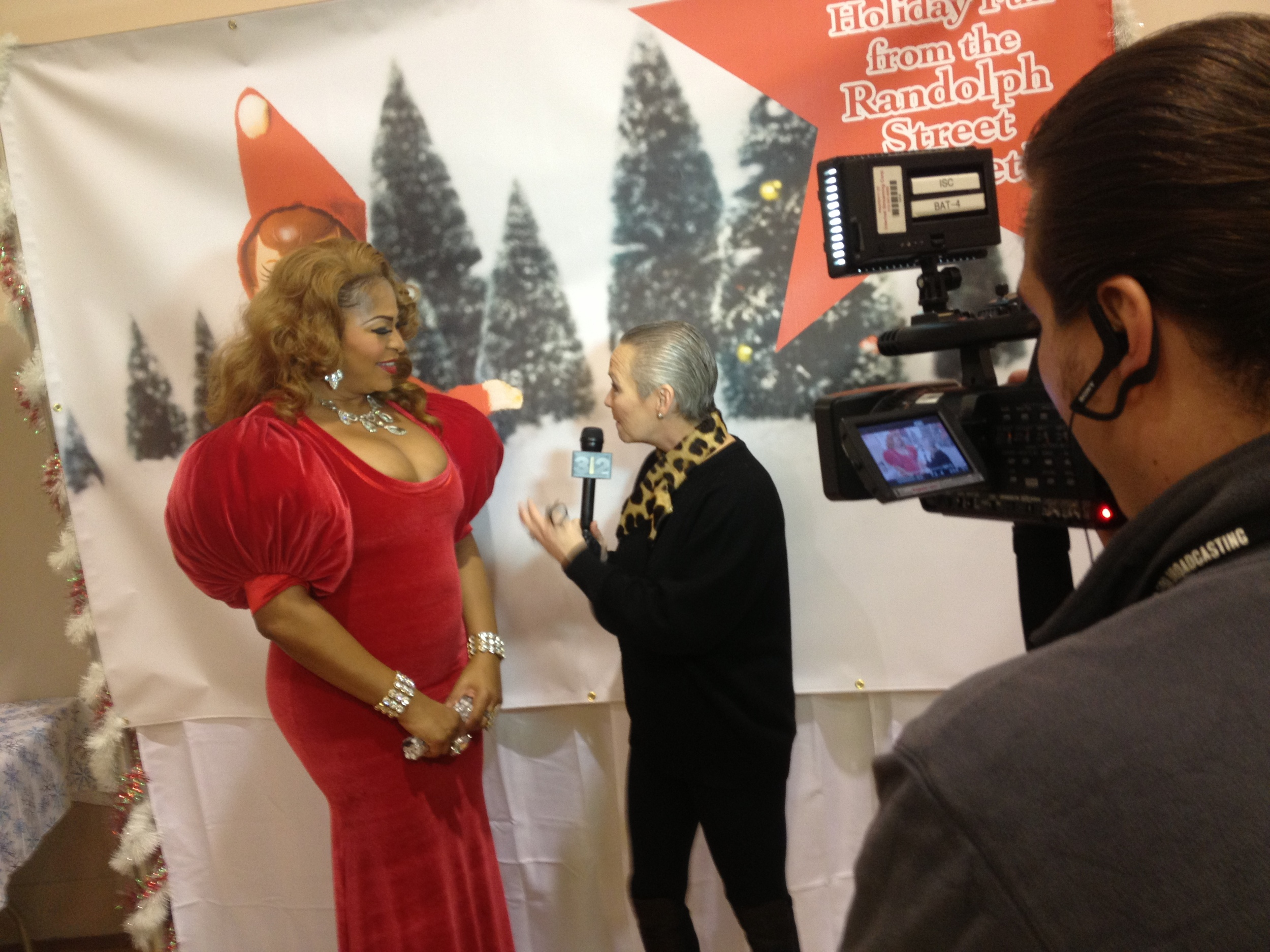 A picture of Candid Candace from Watch 312 interviewing carol singer Traci Ross.