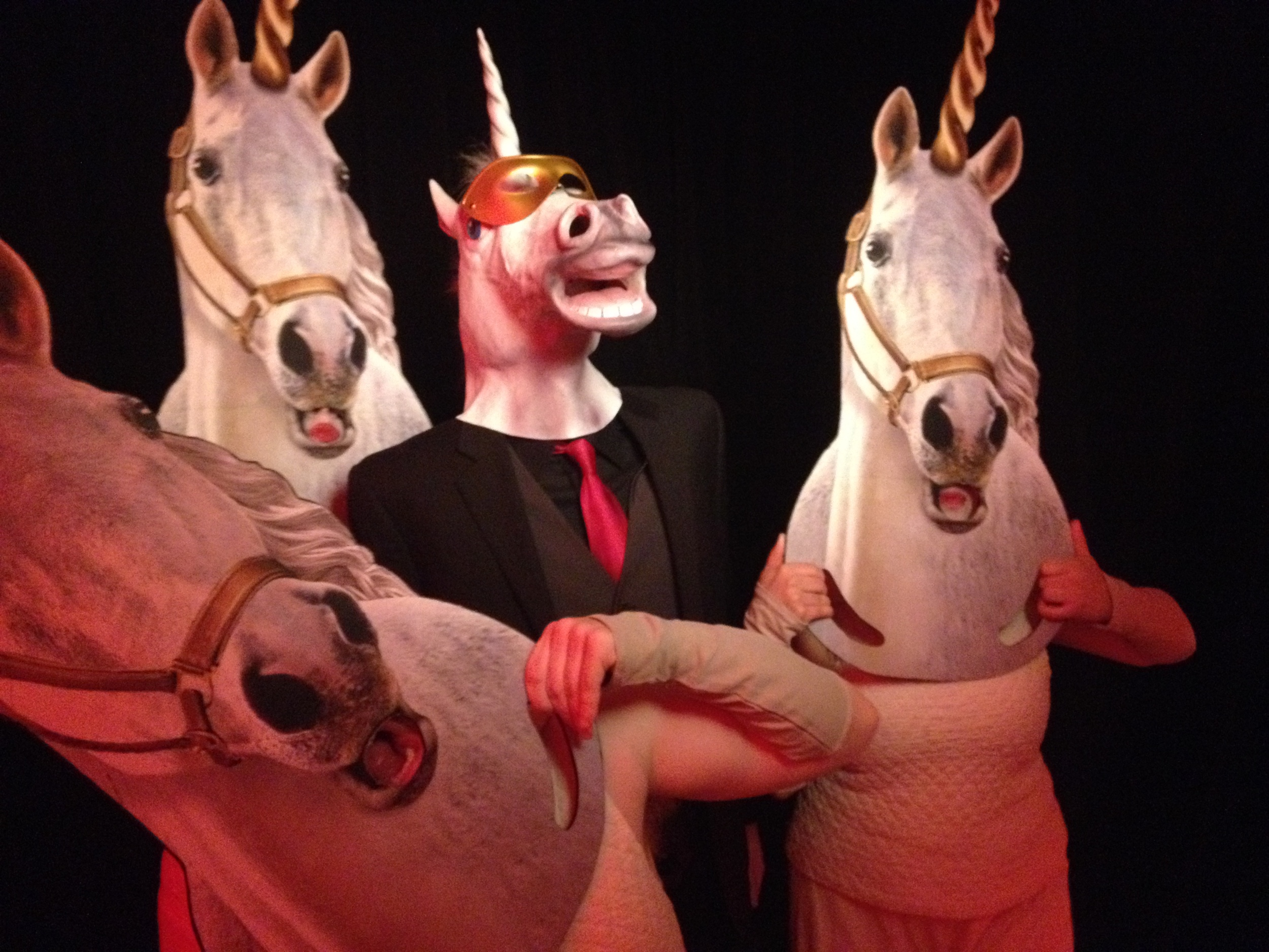 These performance artist unicorns came out of nowhere and were singing and dancing.