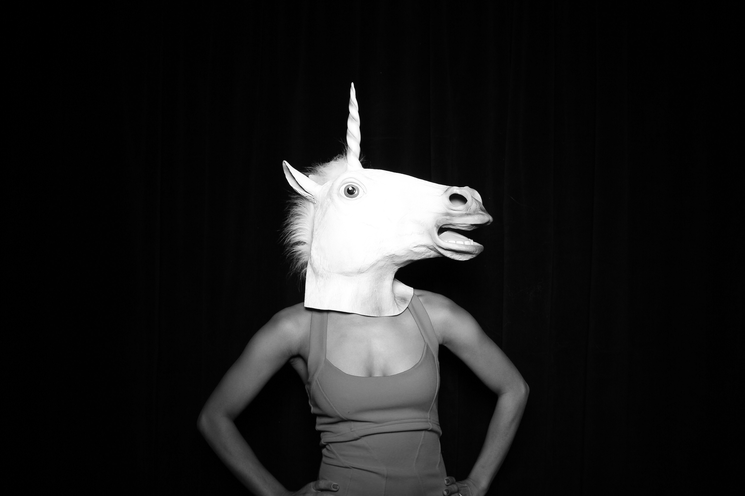 An epic photo booth portrait of a women with a unicorn mask on! Taken at Venue One Chicago.