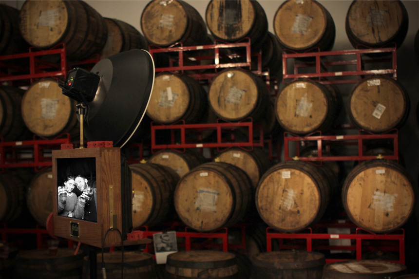 A picture of our vintage looking photo booth against the wooden barrels at Revolution Brewery.