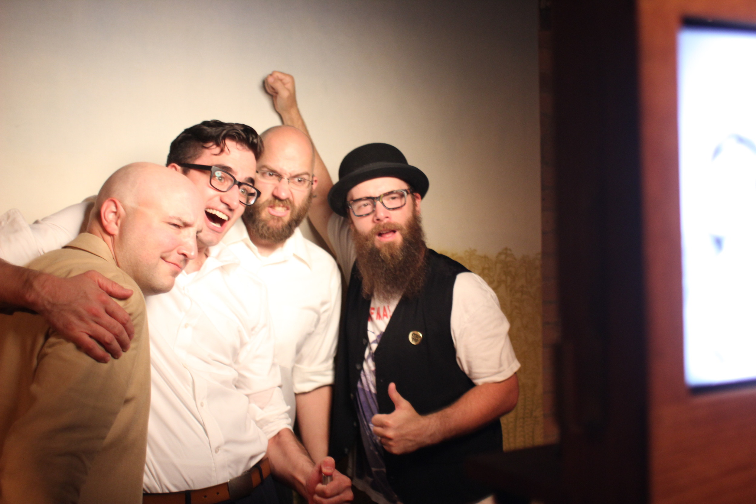 PJ McNulty, Chris Tourre, Jay Eychaner, and Lance Curran from Arcade Brewery pose for a photo booth picture at Lilltstreet Loft!