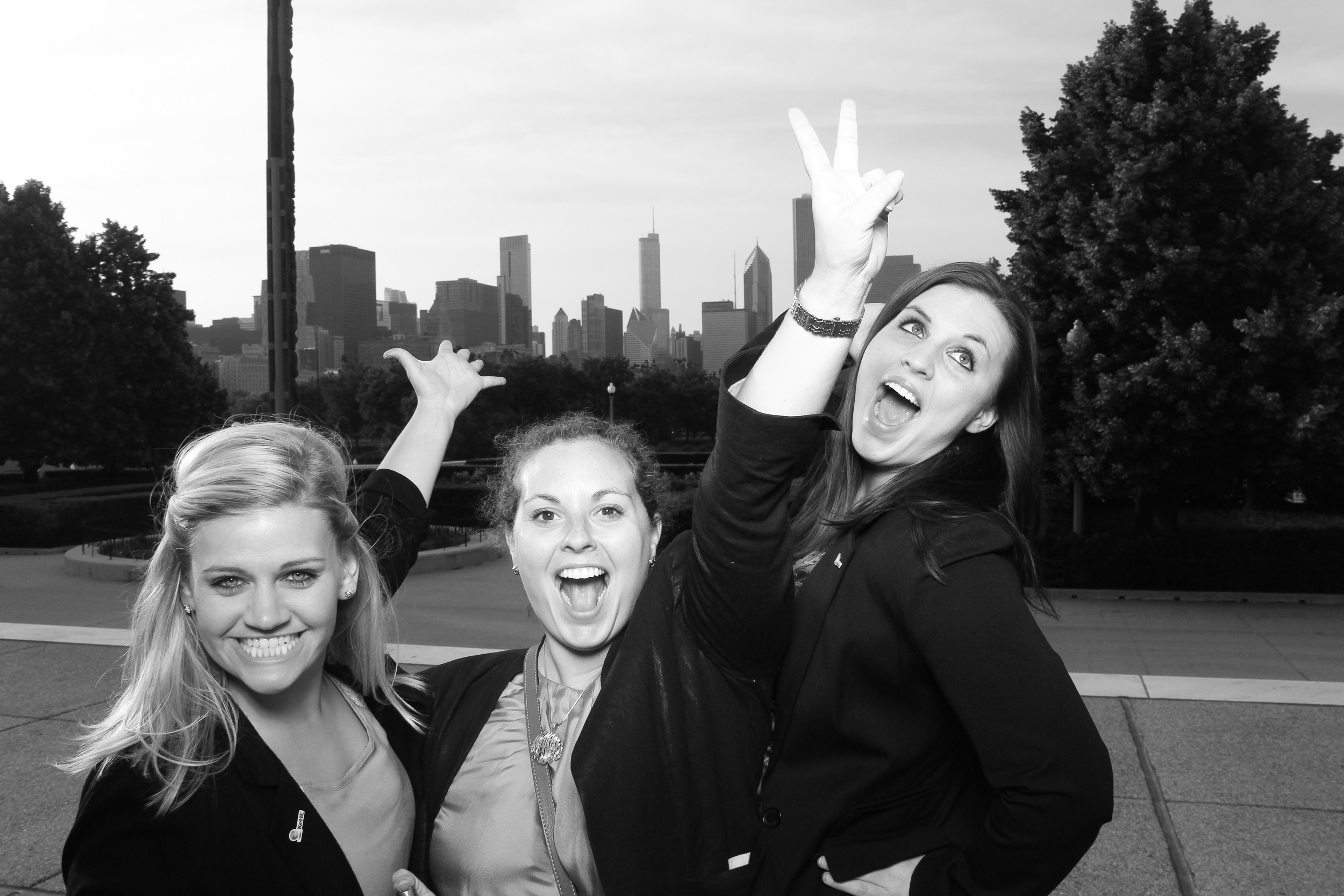Guests pose against the Chicago Skyline for some fun pictures! Everyone looks amazing in Fotio's signature black and white style.