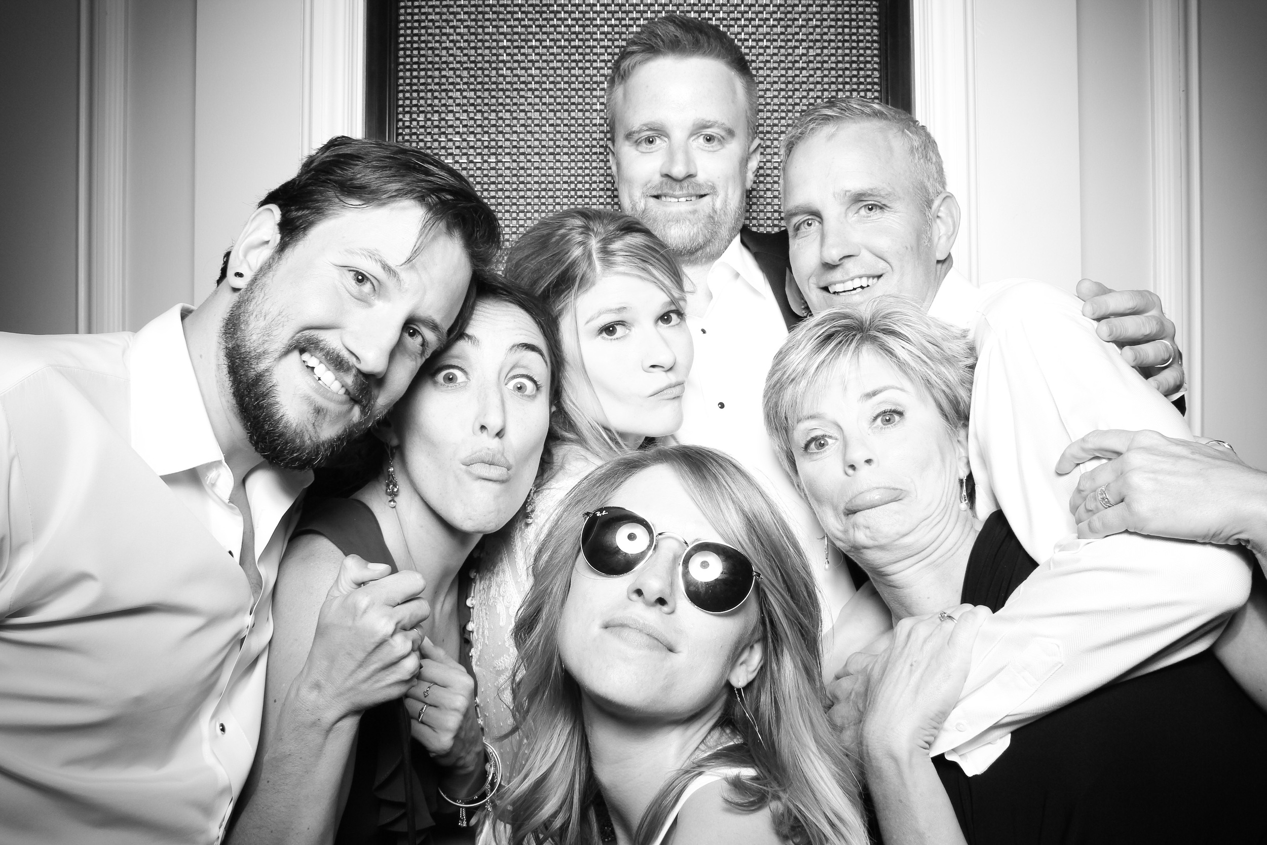 The bride and groom pose for a Fotio photo booth picture with family and friends at the Chicago History Museum!