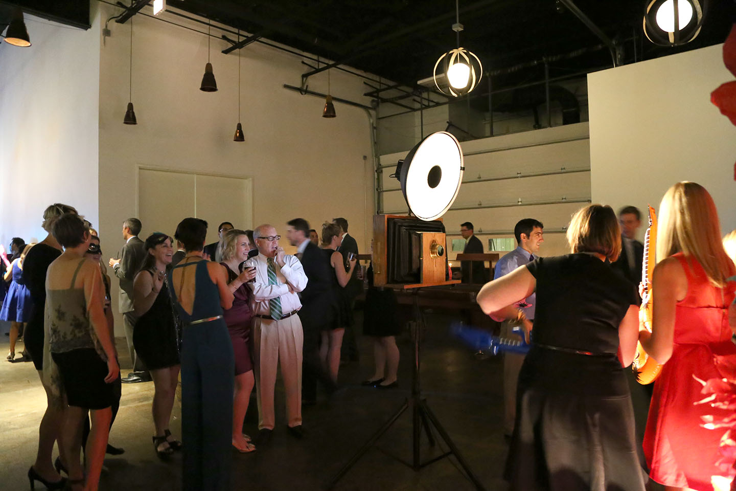 Wedding guests gather around the photo booth at Revolution Brewing!