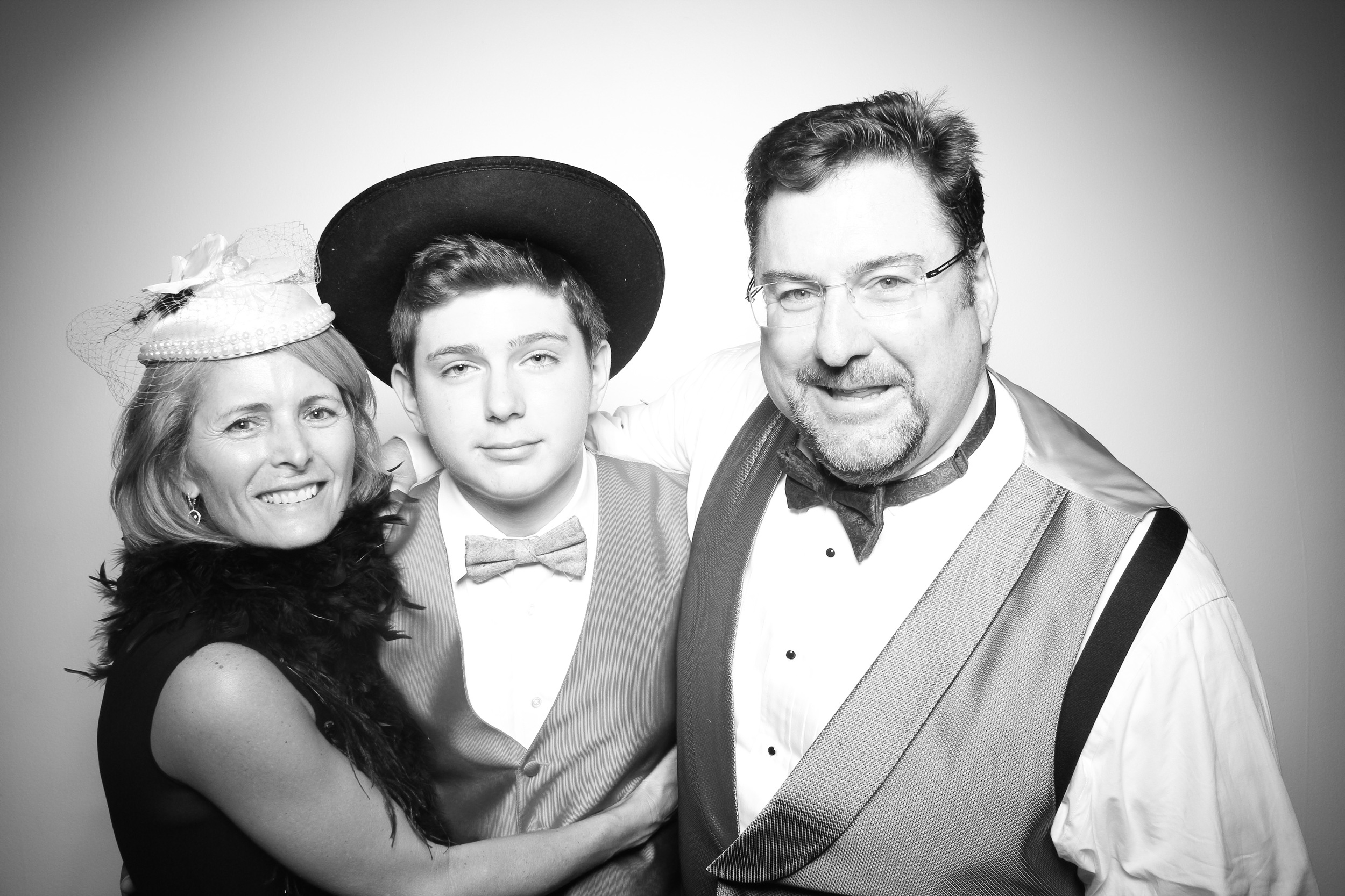 Ryan poses for a photo booth picture with his mom and dad at Venue One!
