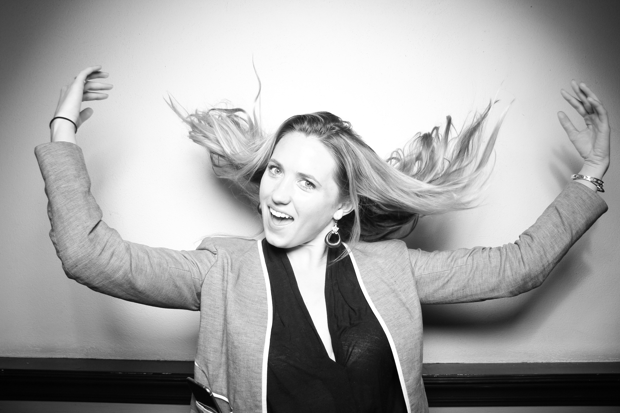 Love this hair flip photo booth picture and the simple backdrop at Le Colonial Chicago!