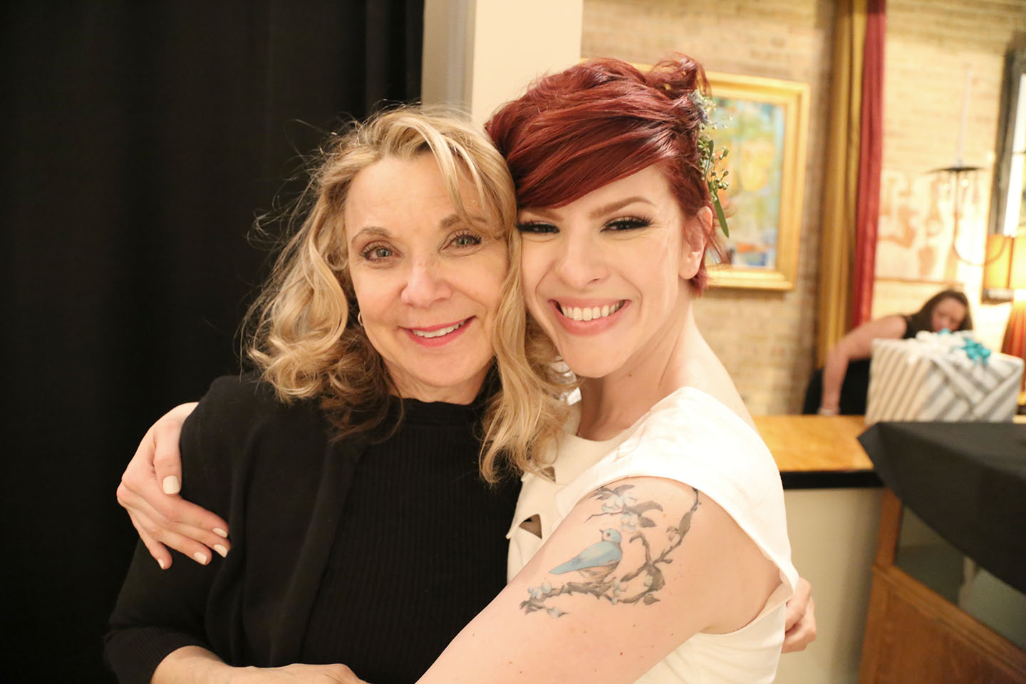 Barb Gadzik poses for a picture with her bride Julie at Mars Gallery Chicago. Photo by  Rachel Smith.