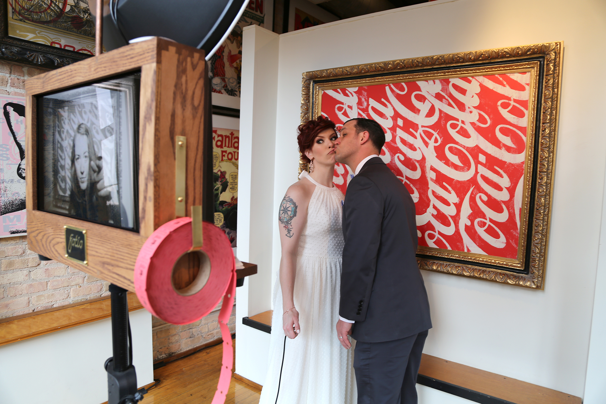 Julie and Matt take a picture with their wedding Fotio booth at Mars Gallery Chicago! Photo by  Rachel Smith.
