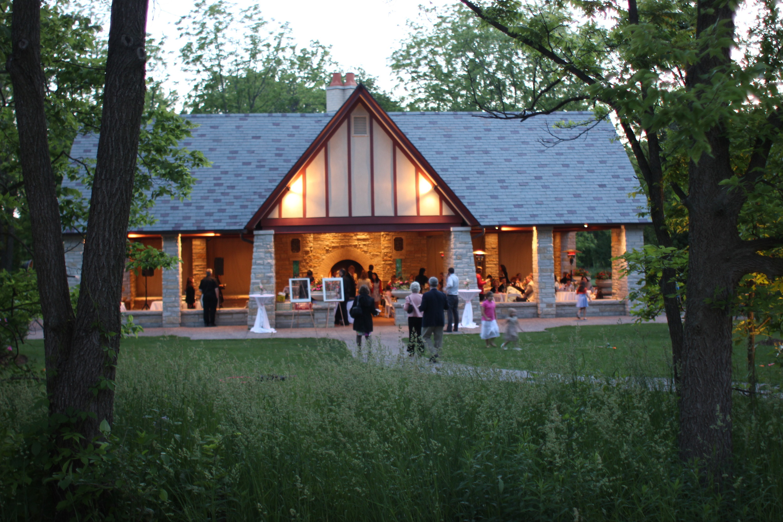 A view of wedding guests having fun in the pavilion at the Grove Redfield Estate in Glenview, IL.