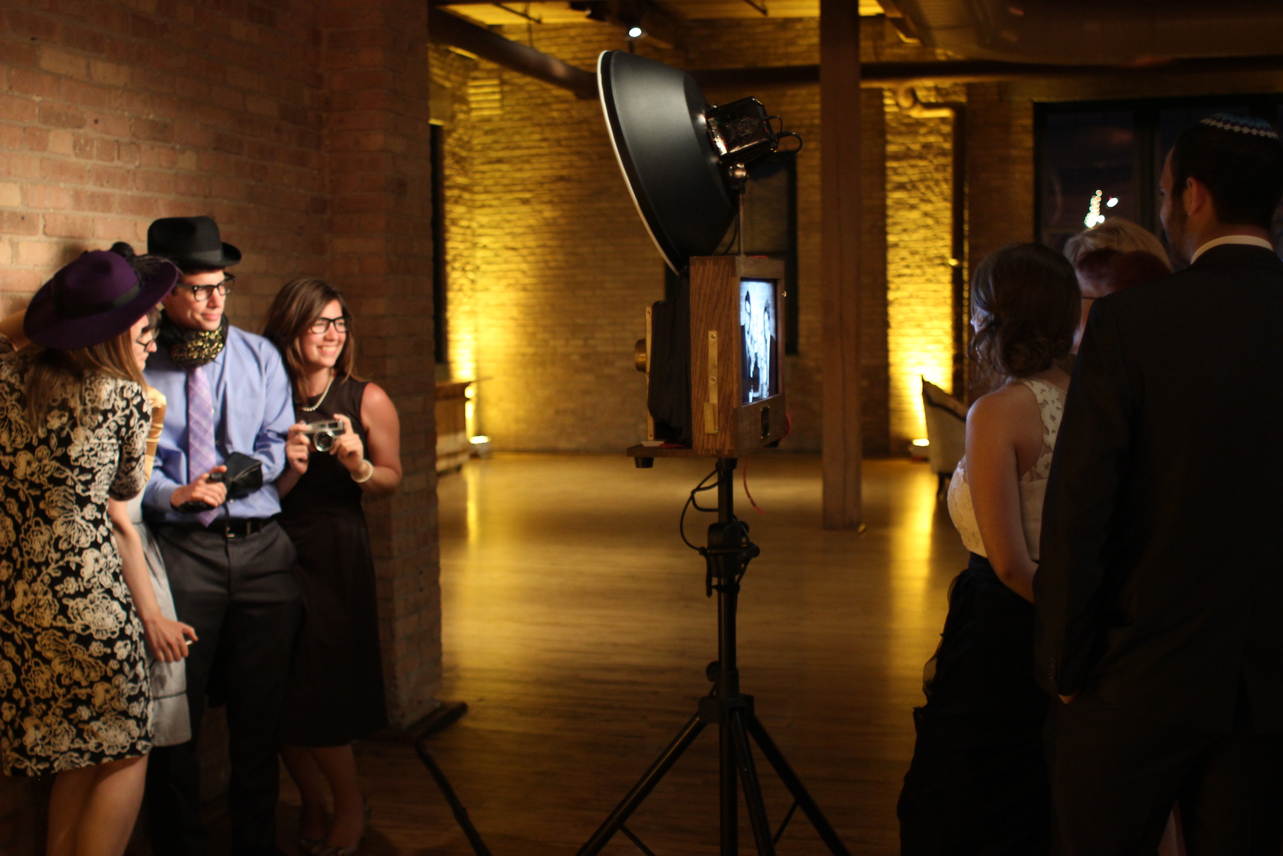 The Fotio photo booth in full action in the Skyline Loft at Bridgeport Art Center wedding.