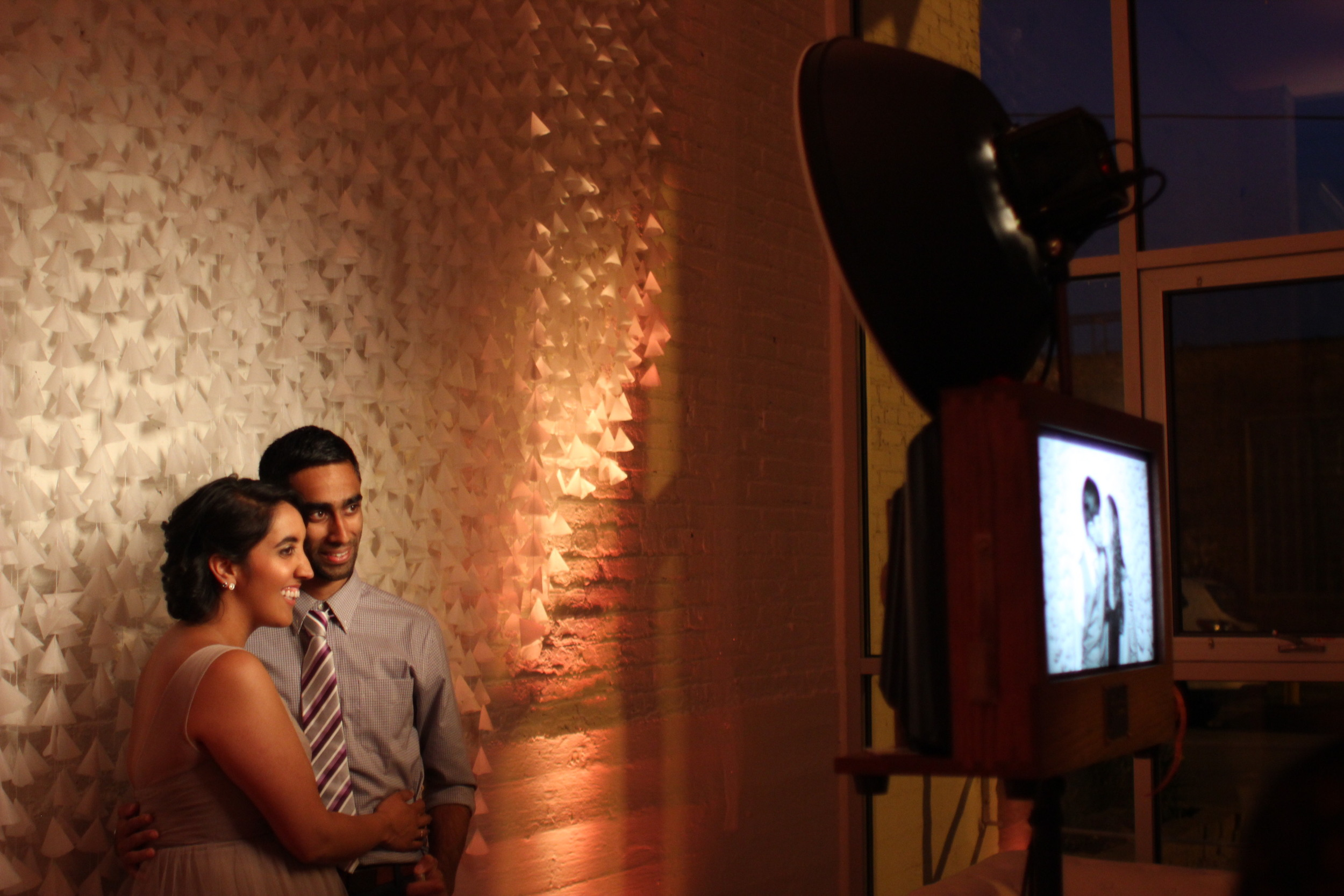 Wedding guests at Room 1520 having fun with the photo booth!
