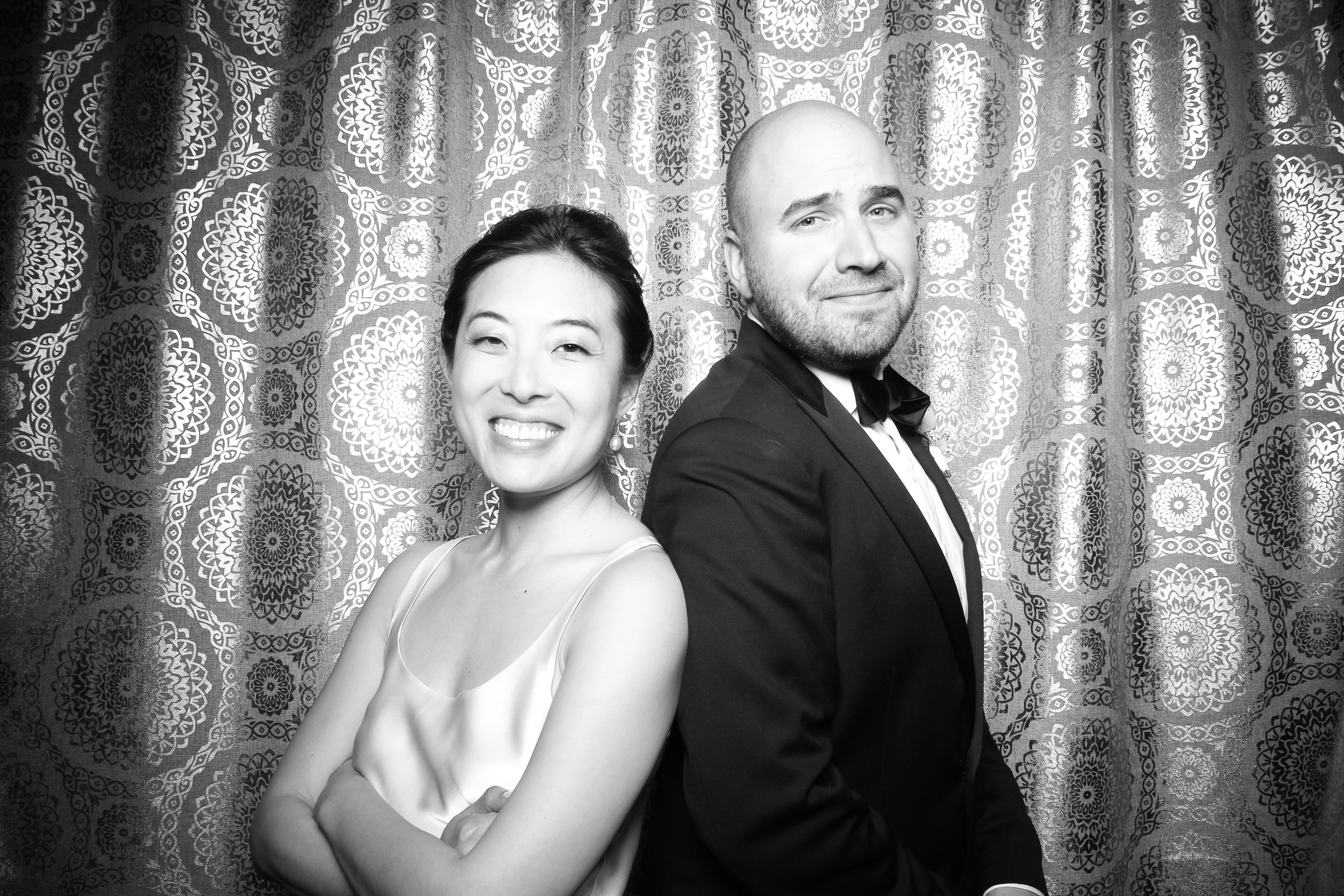 The bride and groom take a photo booth picture at the Adler Planetarium!