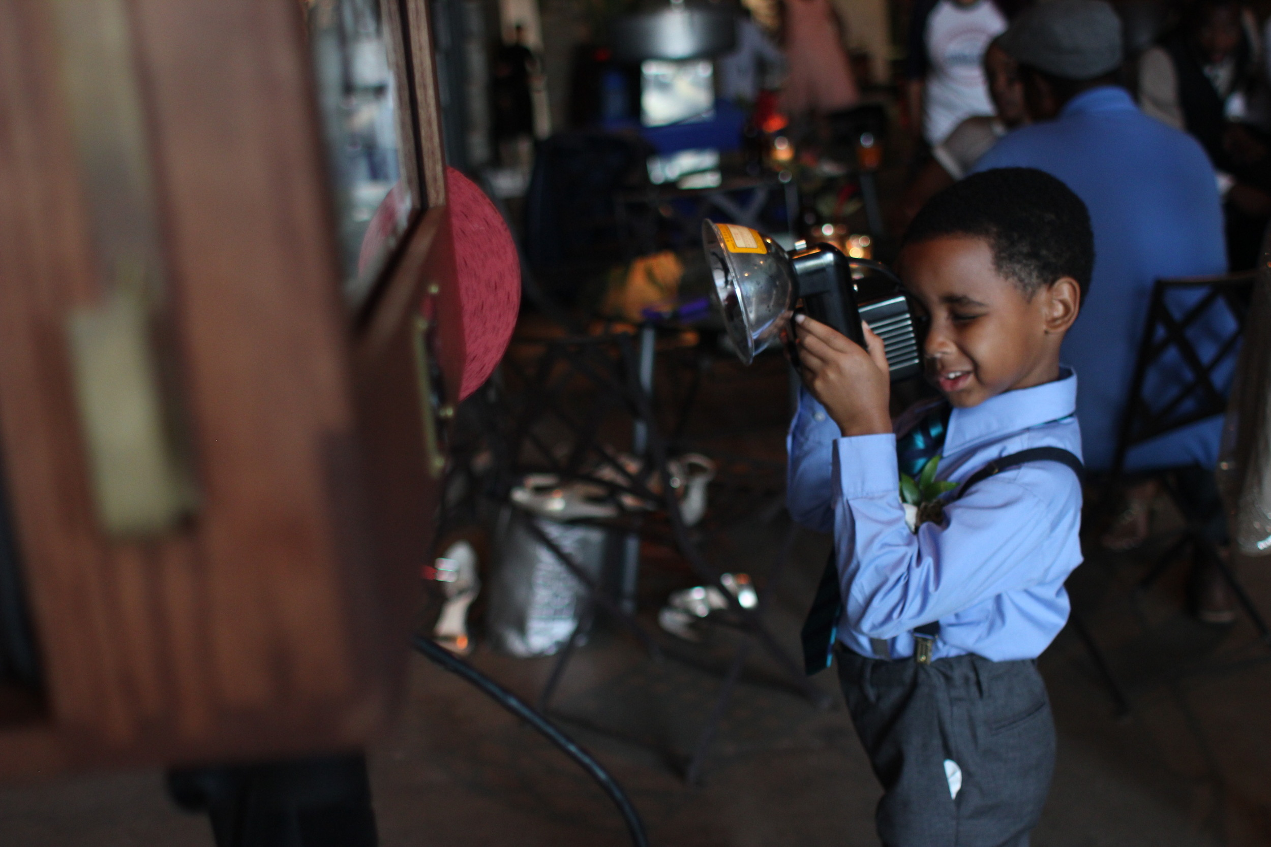 This little guy loved the vintage props - especially the Brownie Camera! Future photographer in training here!