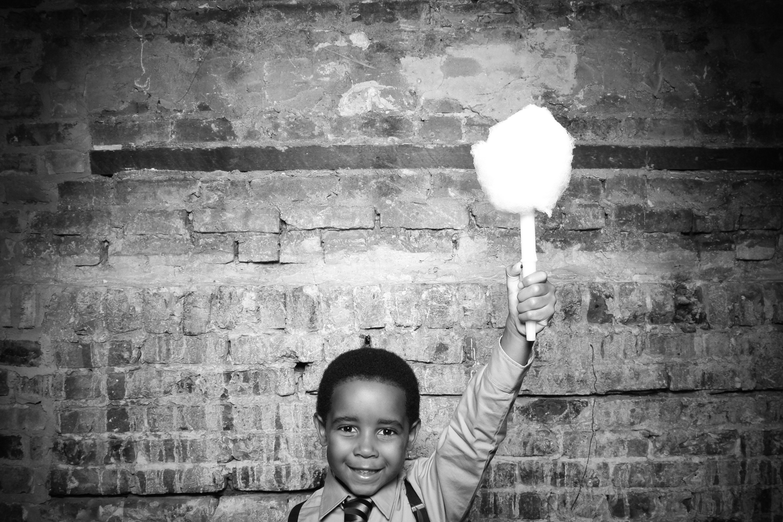 Having fun in the photo booth with cotton candy from Spin-Spun Chicago vendor!