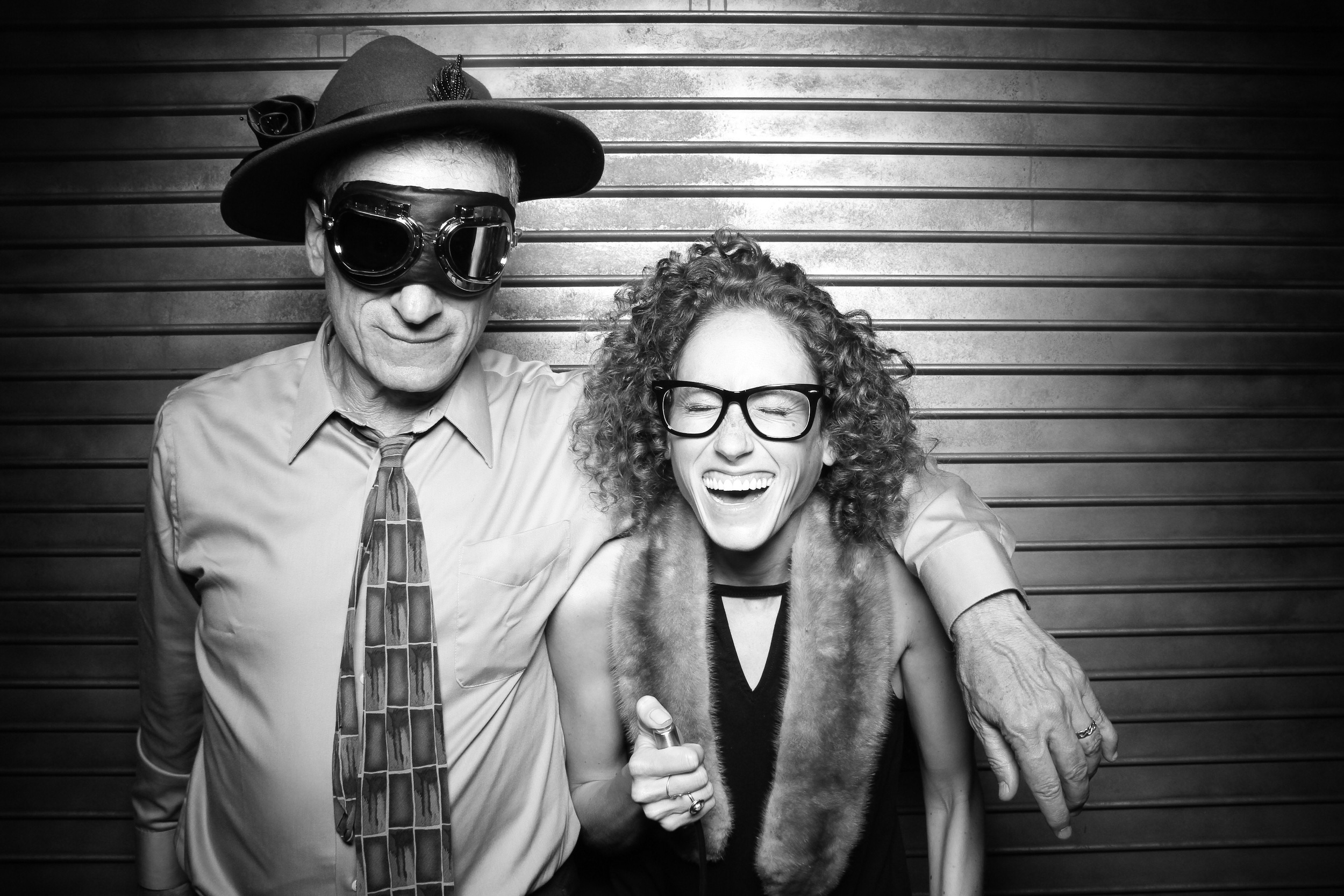 Guests pose for a fun photo booth picture at Morgan Manufacturing!