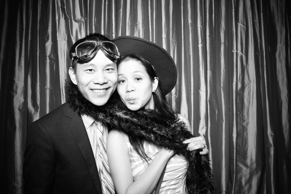 Wedding guests pose for a photo booth picture at Sepia Chicago!