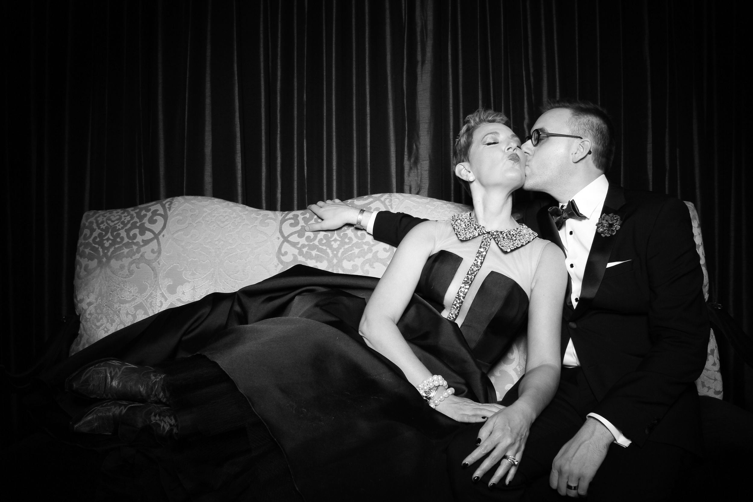 Fun couple having fun and relaxing with the photo booth at the Drake Hotel Chicago!