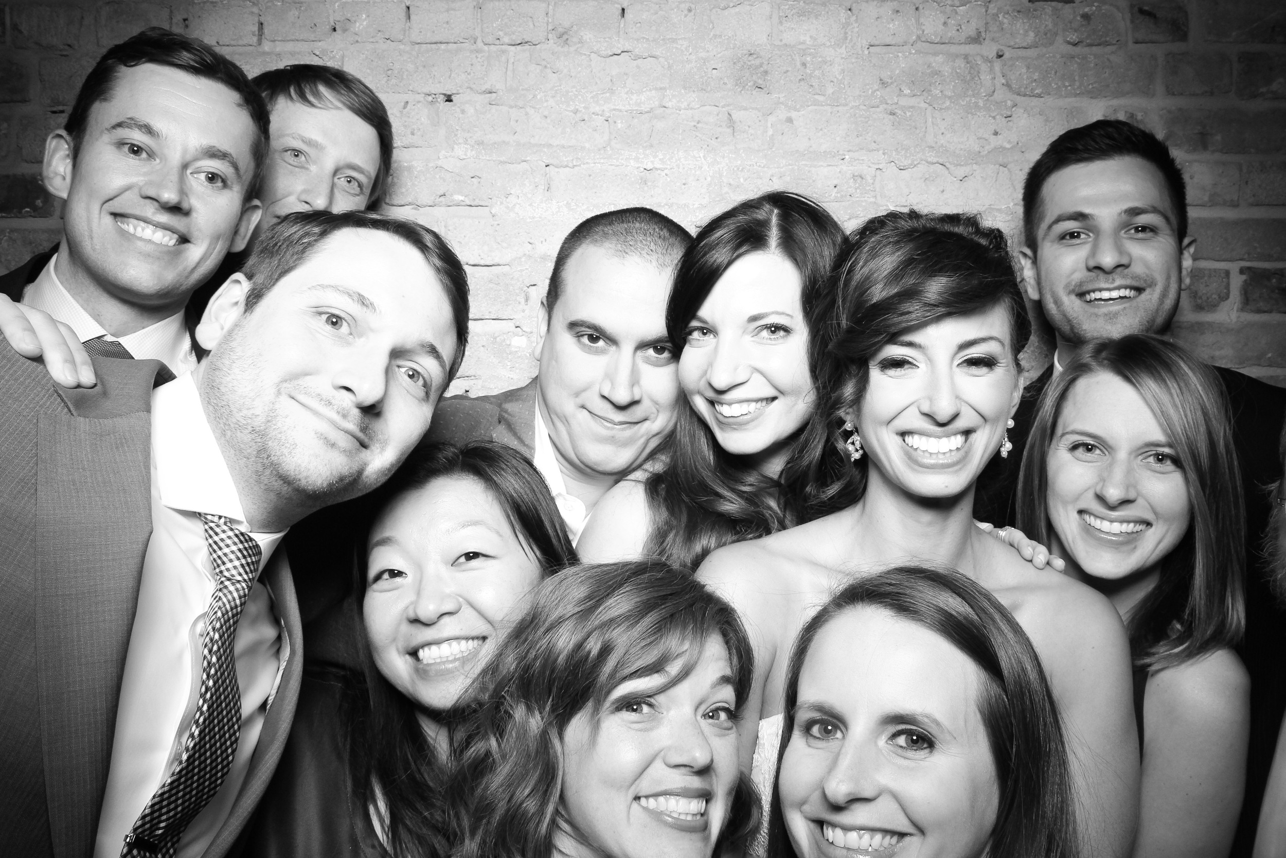 Bride and groom take a group shot with friends!