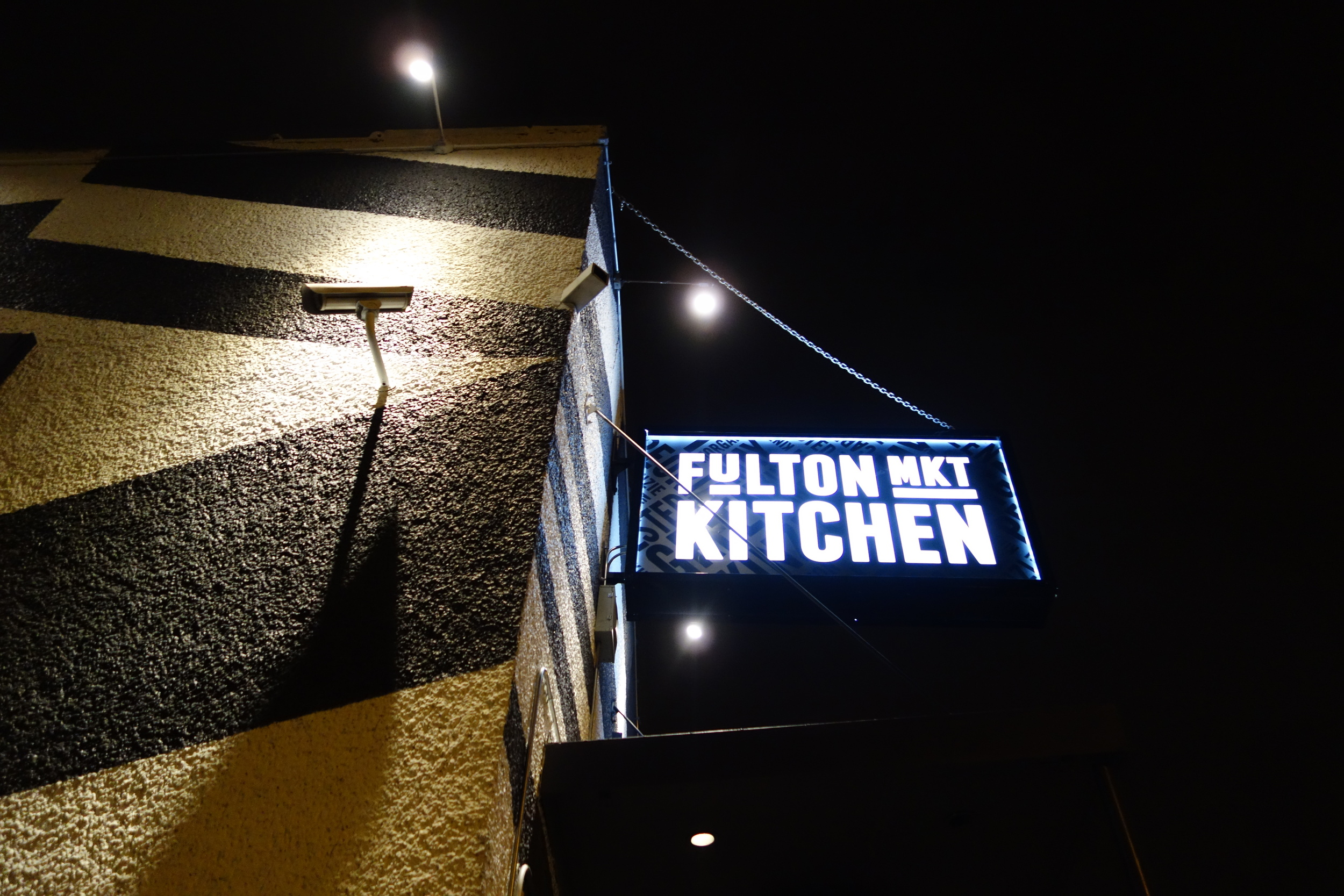 The outside sign for Fulton Market Kitchen in Chicago's west loop.