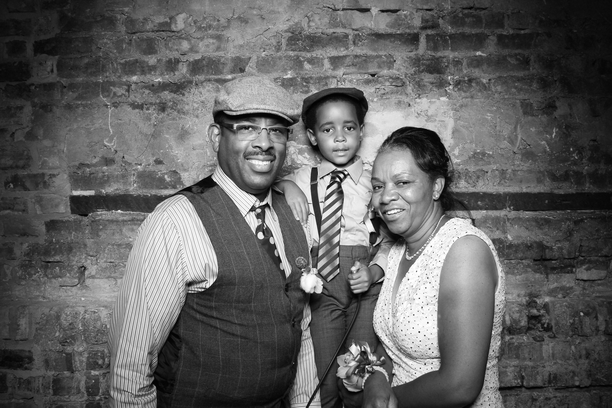 This dapper boy take a family selfie at A New Leaf Chicago wedding in Lincoln Park!