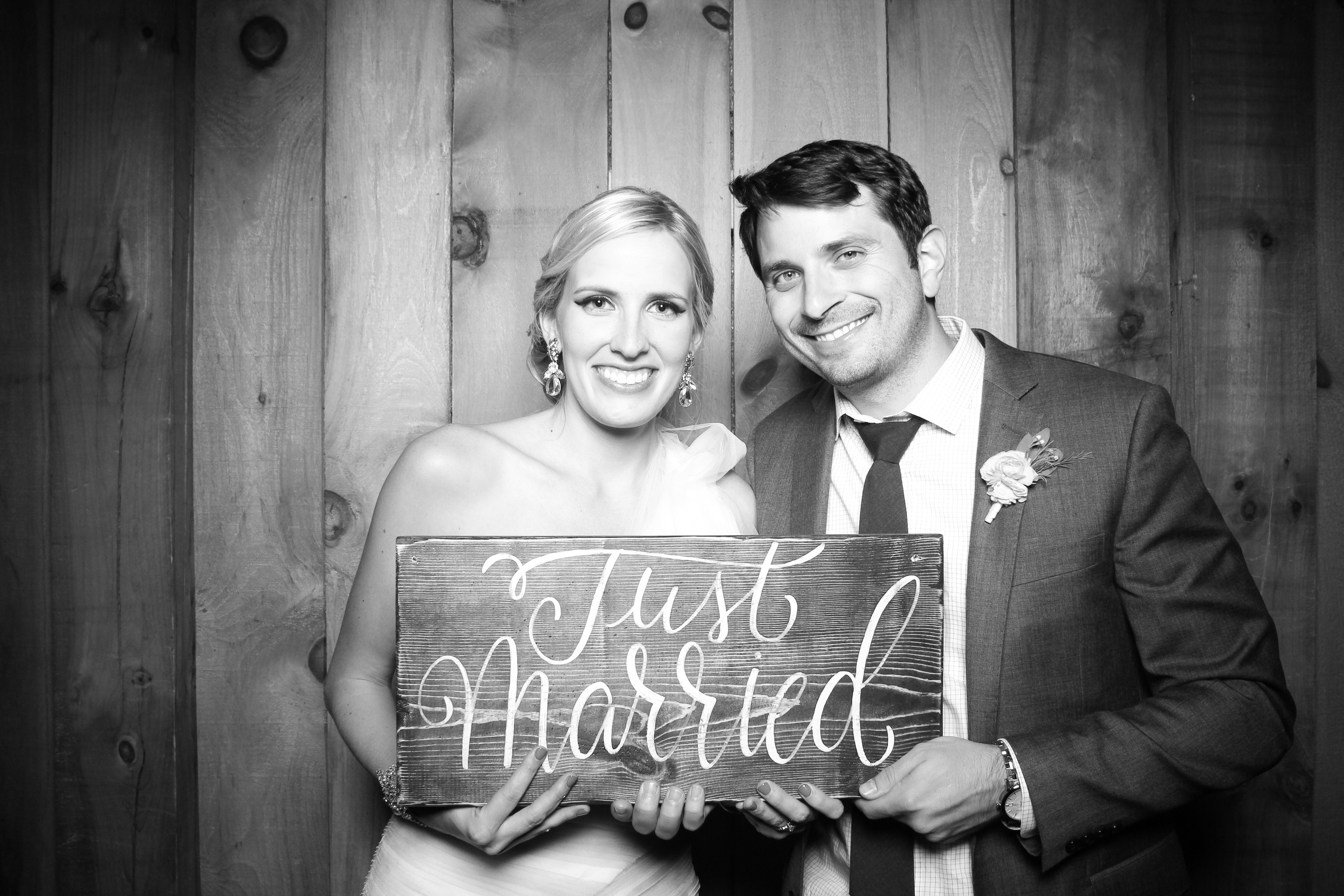 The bride and groom take a photo booth picture at County Line Orchard in Hobart, Indiana!