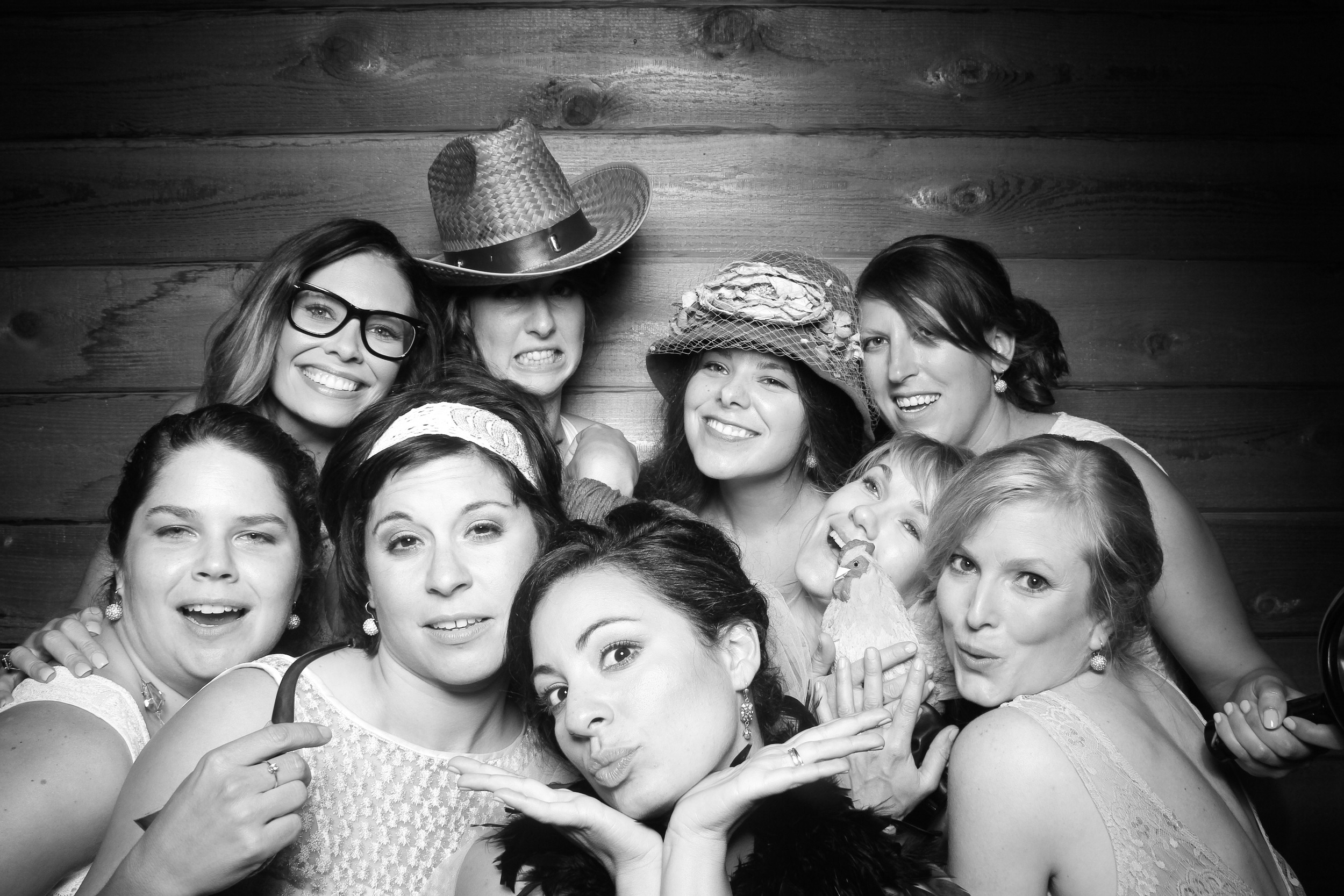 The bride gets a photo booth picture with her besties at Donley's Wild West Town in Union, IL!