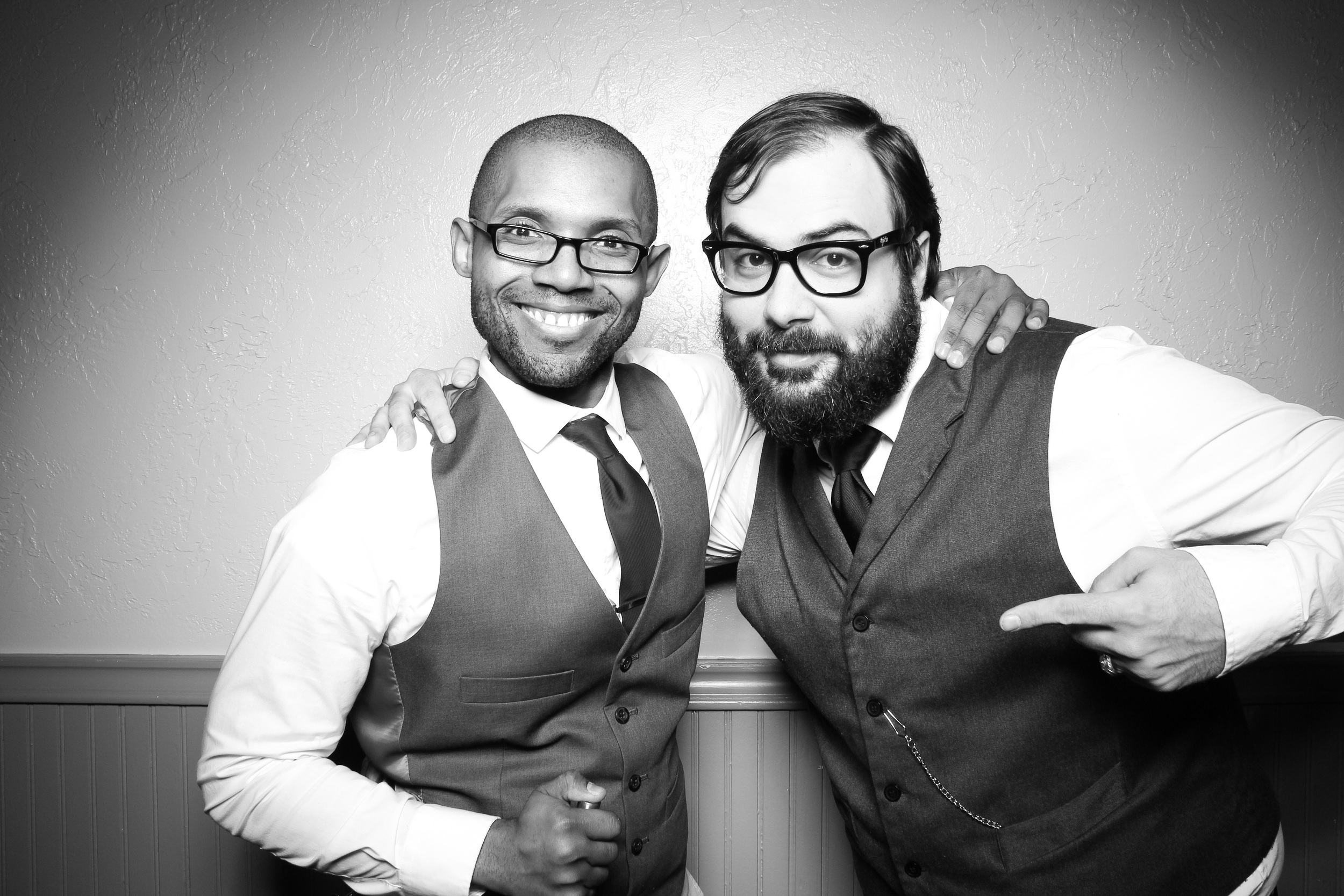 Fotio attendant Nick Harvey and Chicago DJ Brent Rolland pose for a photo booth picture at River Roast!