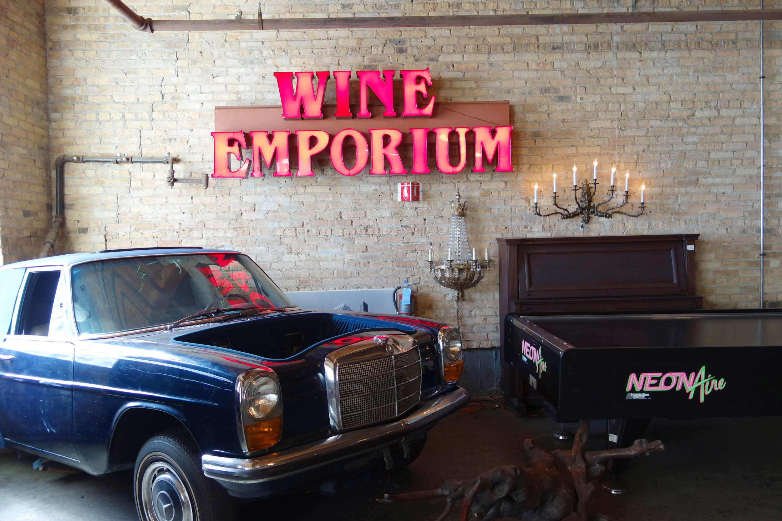 Salvage One has the best vintage treasures! Air hockey table seen here with Wine Emporium sign and classic blue Merdedes-Benz car body!