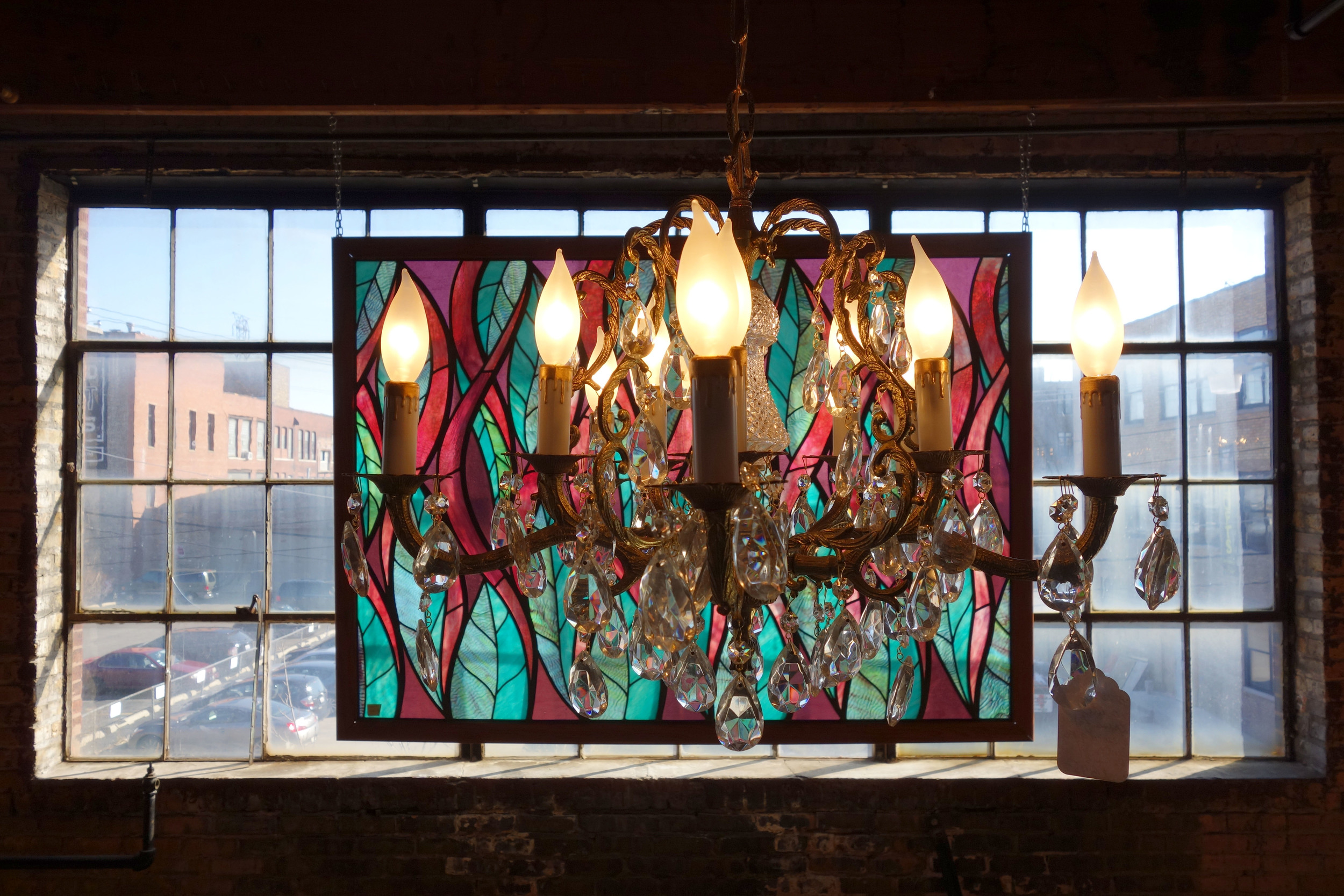 This view though, it is gorgeous. Stained glass windows filter the light that enters the second floor event space at Salvage One.