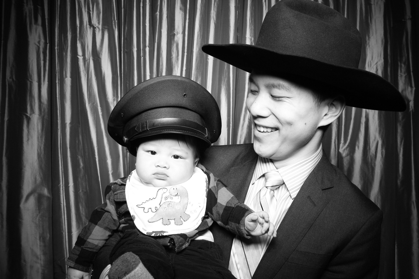 Father son at Sepia! Looking very cute with their props!