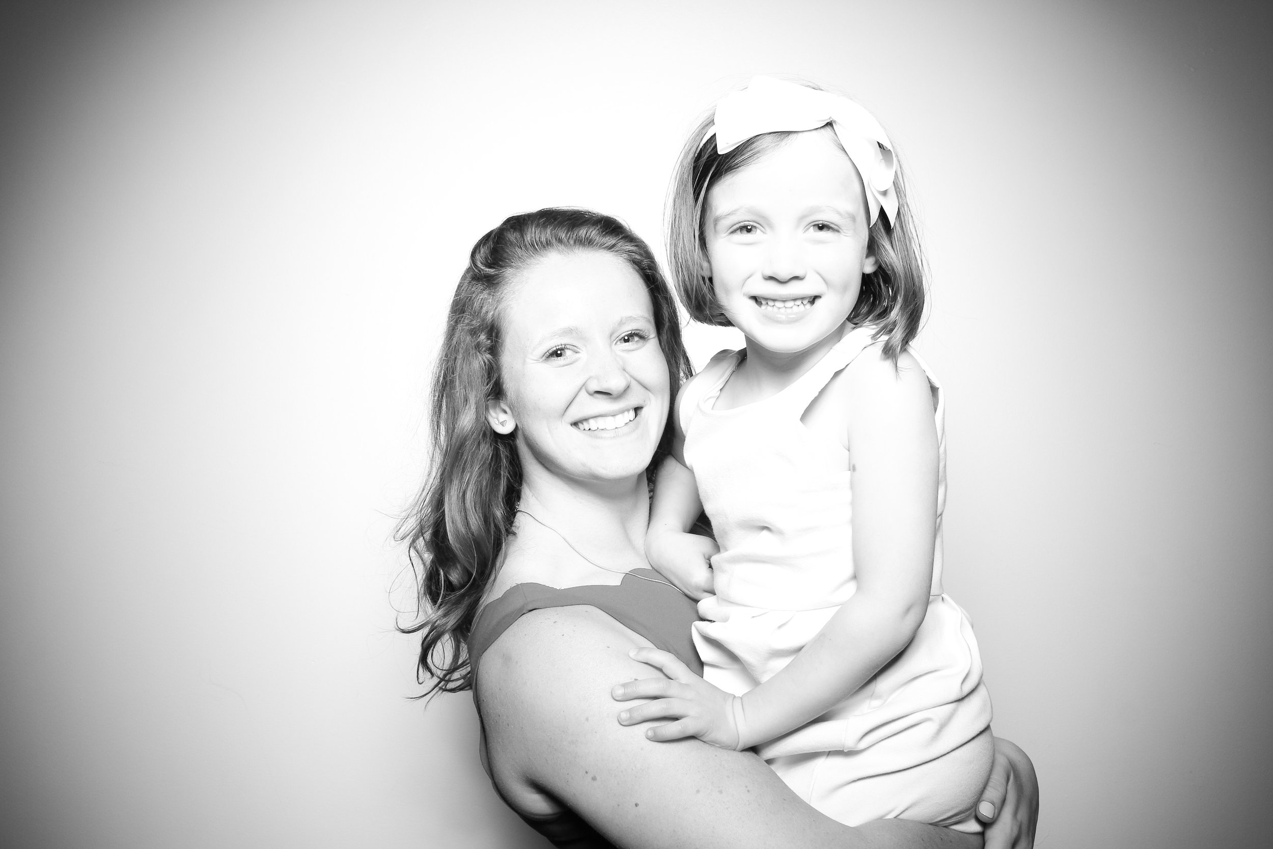 The flower girl poses for a photo booth pic at Ravenswood Atrium Loft!