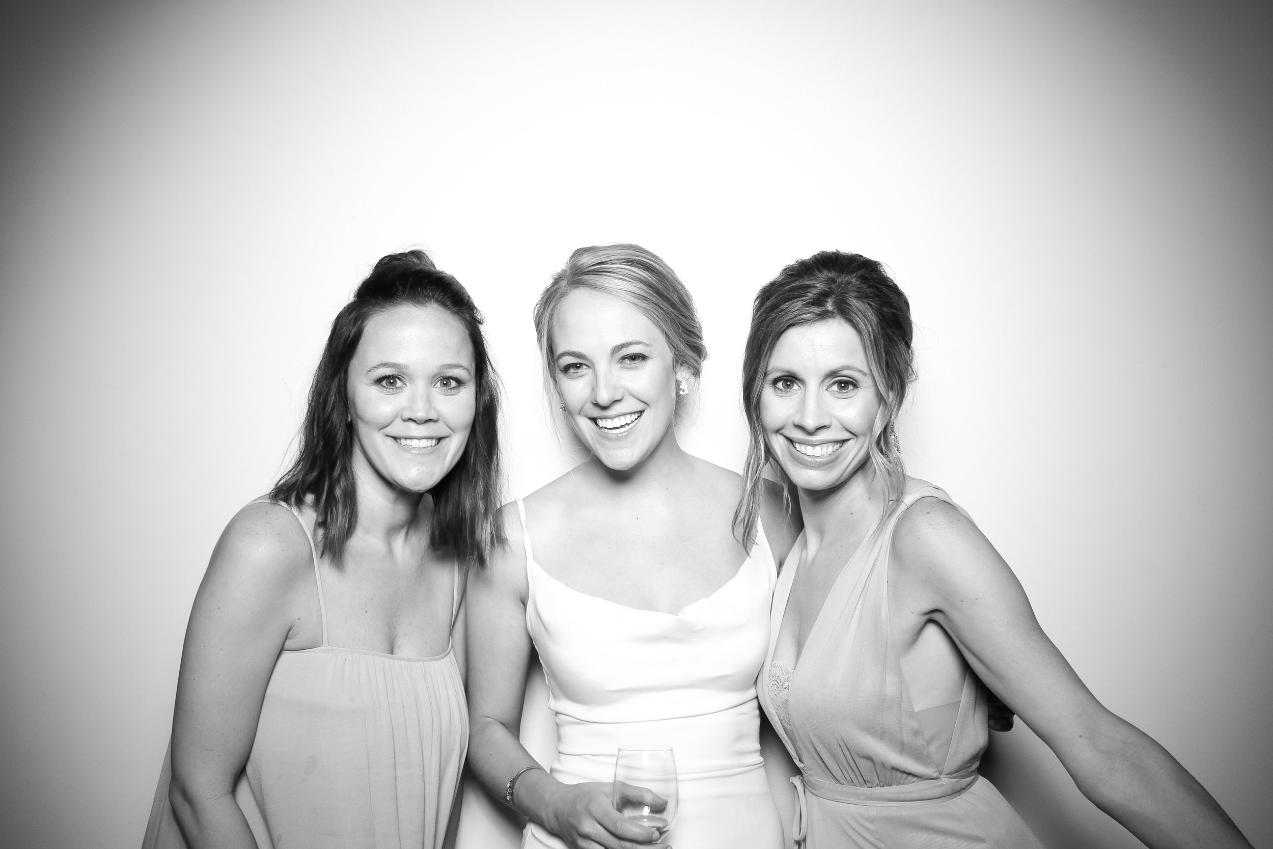 The bride poses for a pic with friends in the Atrium Loft!