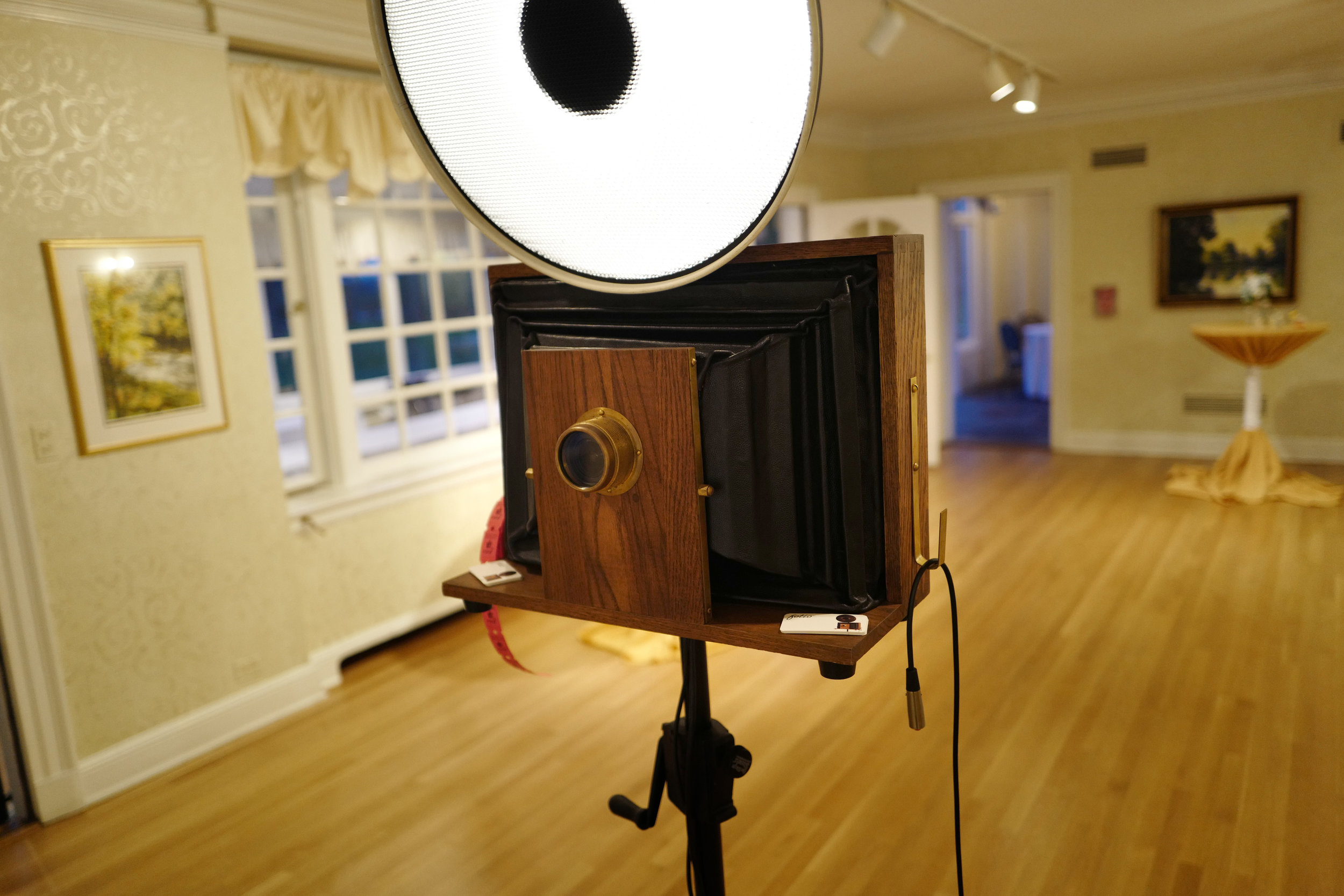 """A Fotio photo booth setup in the Danada House """"Living Room"""" cocktail hour space."""