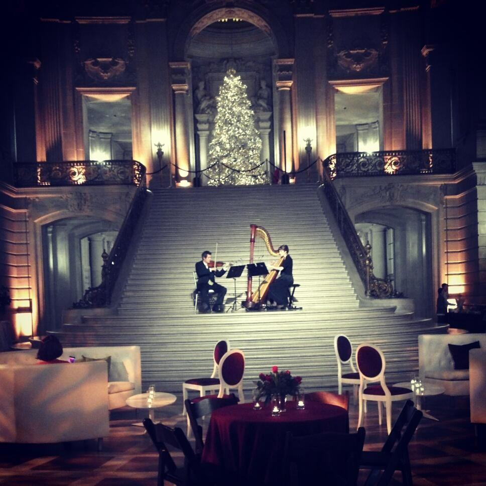 GOOGLE  hires a violinist and harpist to perform at their 2012 holiday party inside San Francisco City Hall's rotunda