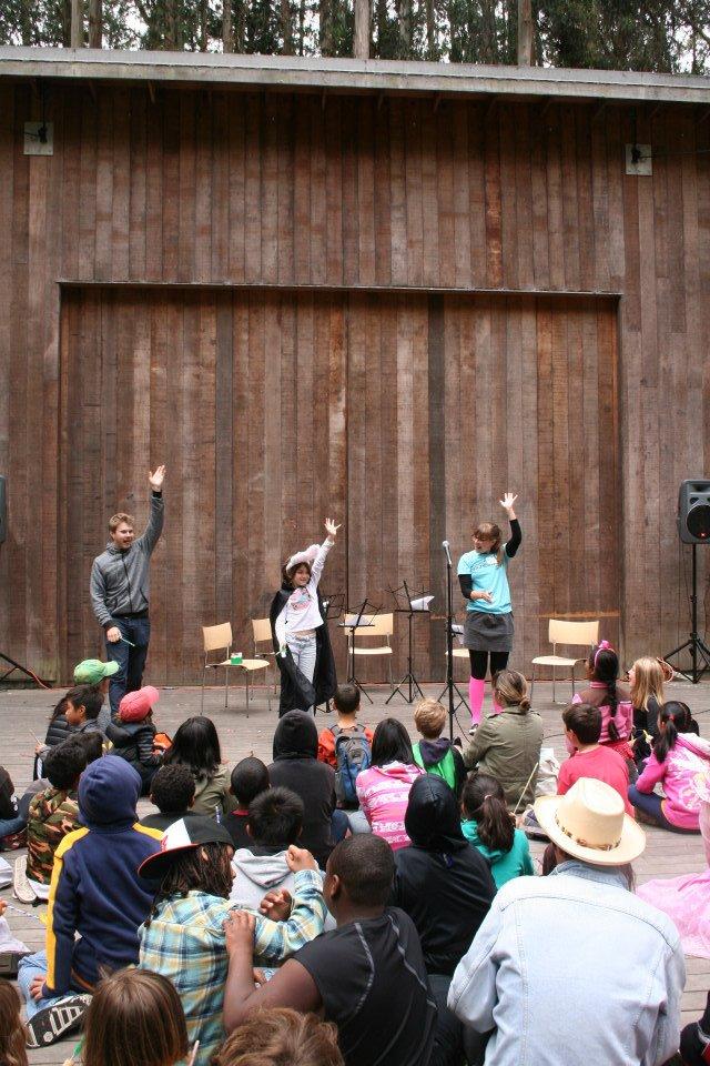 Annie and Matthias teach a costumed young camper