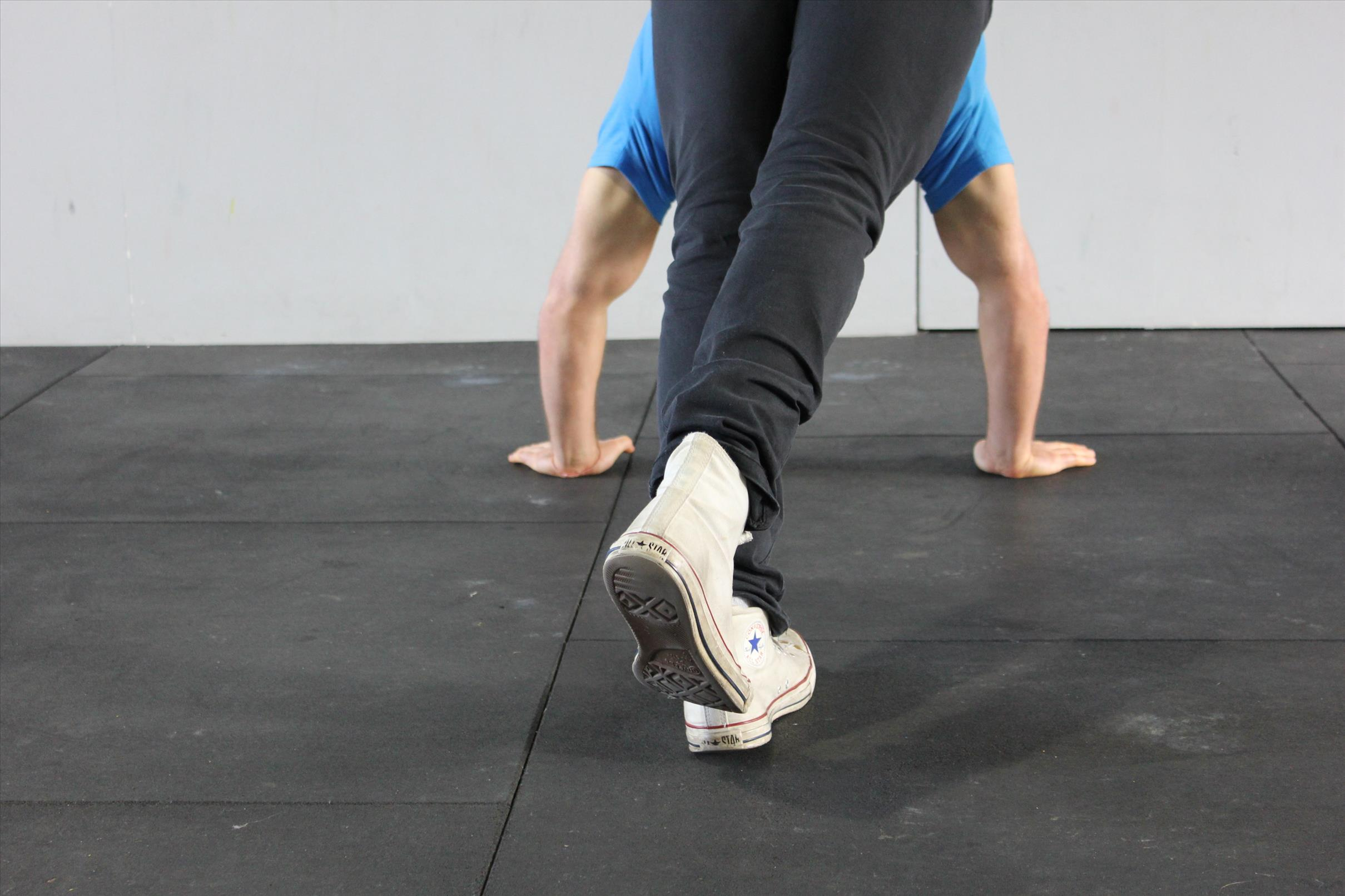 Move the base foot from side to side maintaining pressure on the back of the heel