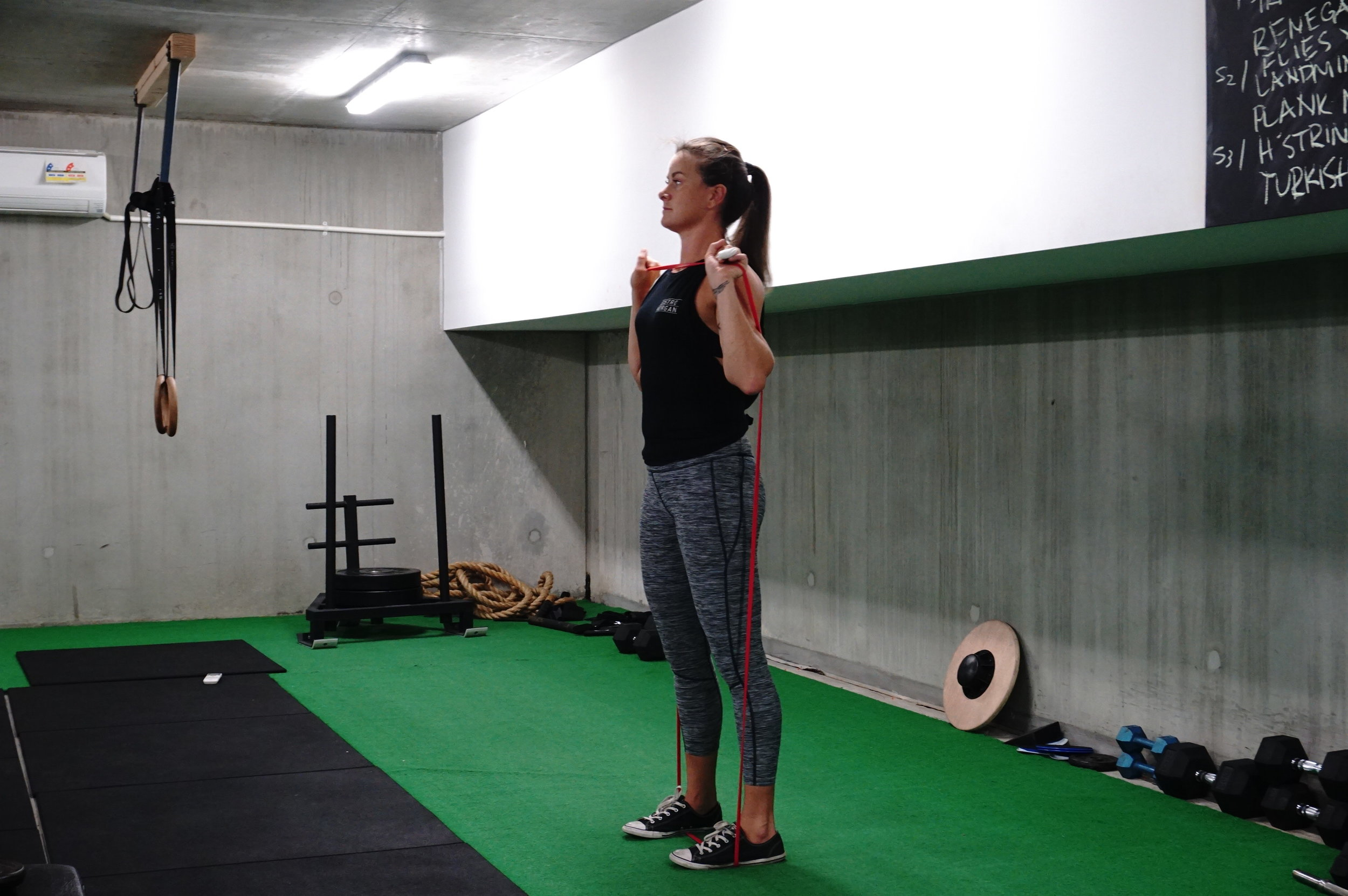 banded overhead shrug hold