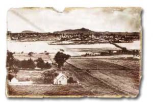 Manukau Harbour and Onehunga from Mangere Bridge, before the urbanization of Onehunga.