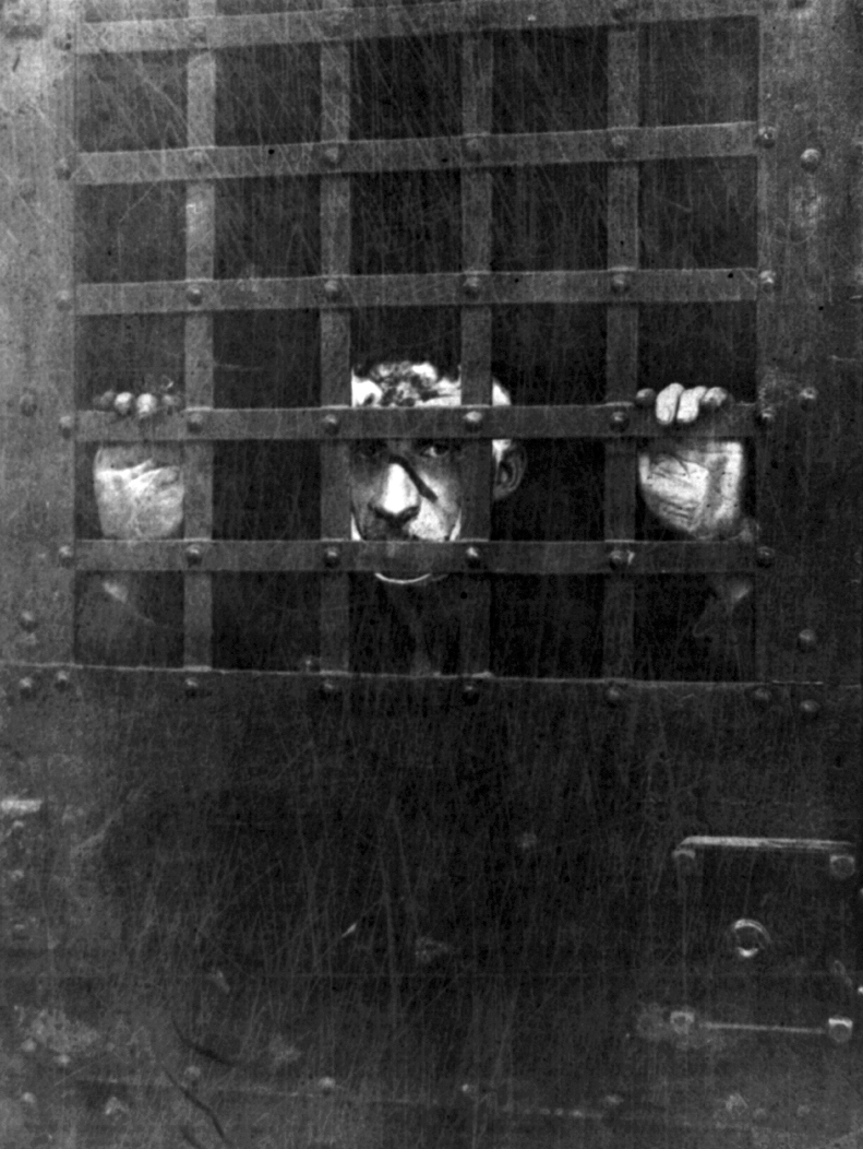 Leon Frank  Czolgosz,  the assassin of President William McKinley, behind bars