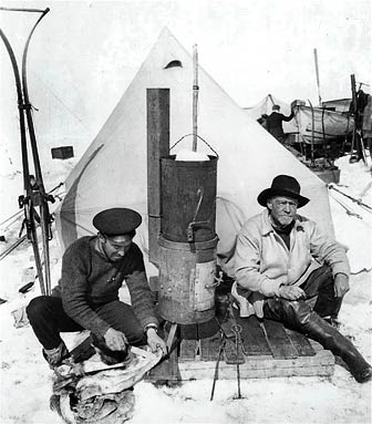 Frank Hurley and Ernest Shackleton at camp. This photograph was published in the United States in Ernest Shackleton's book, South, in 1919.