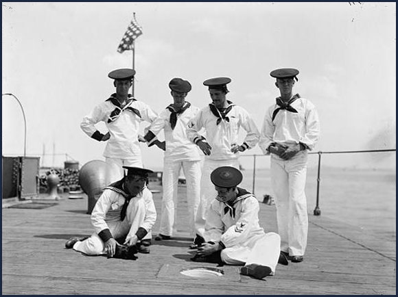 Sailors on USS  Nahant  playing with two cats, circa 1898.
