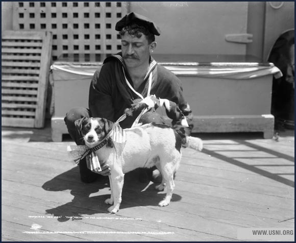 "Sailor with ""Mike,"" mascot of USS  New York , circa 1899."