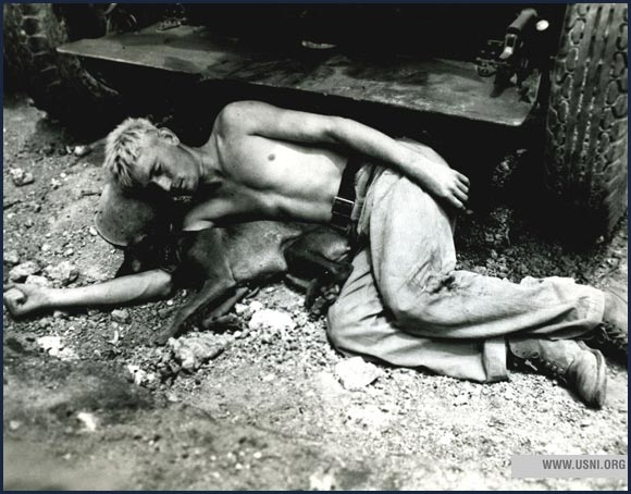 US Marine private takes a nap with his division's mascot while on Okinawa, 1945.