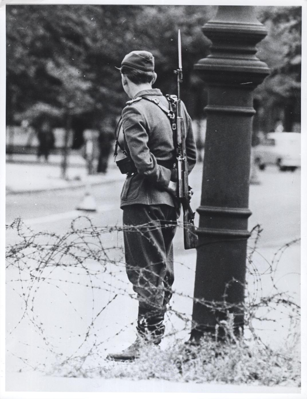 An East German soldier guarding the newly-formed Berlin Wall in August 1961.