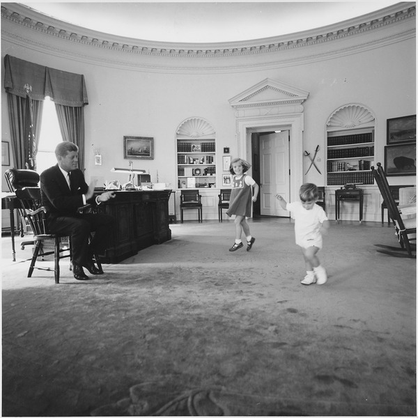 Kennedy with his children in the oval office.