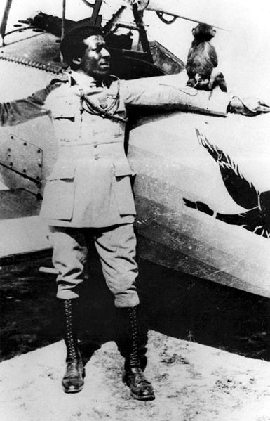 Eugene Bullard with his pet in 1917 as a pilot in the Lafayette Flying Corps in France.