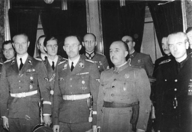 Francisco Franco is the figure second from the right. Nazis Karl Wolff and Heinrich Himmler, and Spanish minister Ramon Serrano Suner also feature.